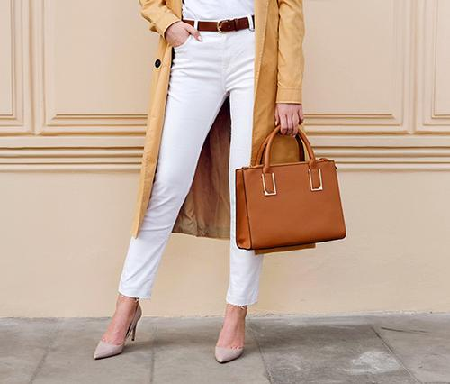 Designer brands resale. Luxury fashion goods and designer bags. Brand Choice mission. Woman holding bag.